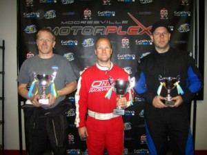 Randy Sampson (c) was credited with the TaG Master win, moving Peter Michel and Justin Halliday to the podium