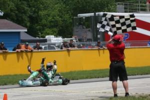 Mick Gabriel celebrates his win in the Leopard 125 II final (Photo: Joe Brittin)